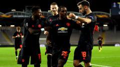 Indosport - Odion Ighalo (kedua kiri) merayakan golnya bersama skuat Manchester United