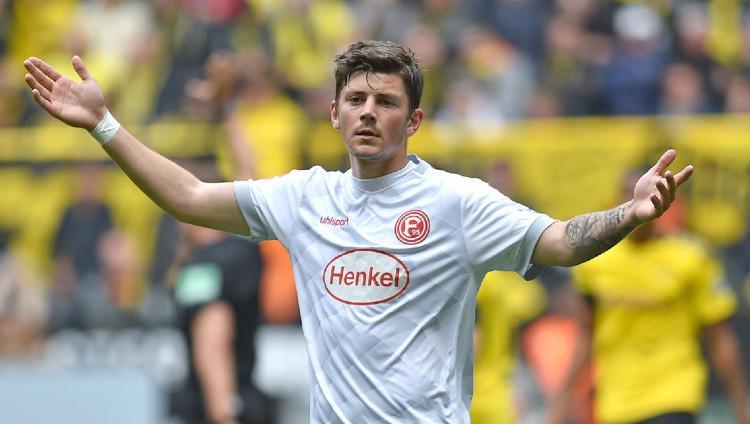 Striker Fortuna Dusseldorf asal Polandia Dawid Kownacki. Copyright: TF-Images/Getty Images