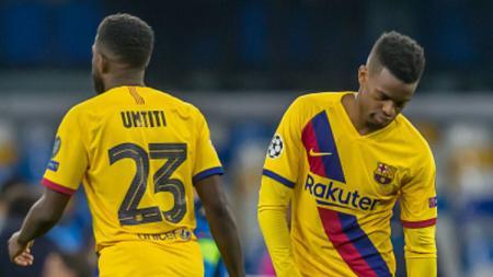 Dua pemain Barcelona, Samuel Umtiti (kiri) dan Nelson Semedo bakal dilepas demi pemain Tottenham Hotspur, Tanguy Ndombele - INDOSPORT