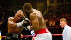Indosport - Danny Williams, sosok 'penghancur' Mike Tyson yang juga merupakan petinju yang memutuskan untuk menjadi mualaf dikabarkan pensiun beberapa waktu yang lalu.