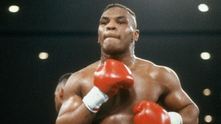 Legenda tinju Amerika Serikat Mike Tyson. - INDOSPORT
