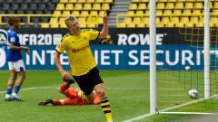 Indosport - Erling Haaland merayakan golnya dalam laga Bundesliga Jerman antara Borussia Dortmund vs Schalke 04