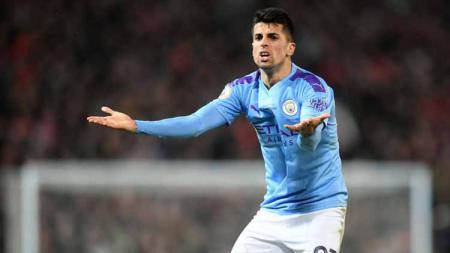 Barcelona dikabarkan meminati dua bek Manchester City yakni Eric Garcia dan Joao Cancelo, dan siap menyerahkan bek kanan Nelson Semedo sebagai gantinya. - INDOSPORT