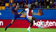 Indosport - Xavier Mbuyamba (Barcelona) masih jadi incaran klub Liga Inggris, Chelsea.