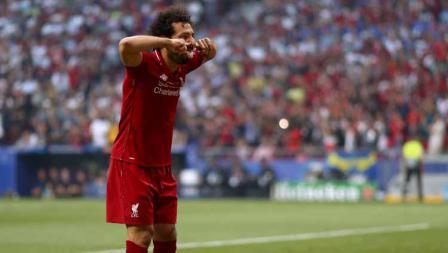 Selebrasi Mohamed Salah setelah mencetak gol pertama Liverpool melalui titik putih.