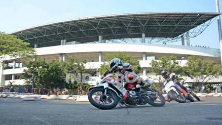 Pandemi COVID-19 atau virus Corona yang menghantam berbagai negara termasuk Indonesia membuat berbagai event olahraga termasuk Motorace Jateng 2020 terganggu. - INDOSPORT