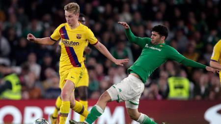 Entrenador klub LaLiga Spanyol Barcelona, Ronald Koeman, mewajibkan para gelandangnya untuk mencetak gol demi membantu tim musim depan. - INDOSPORT
