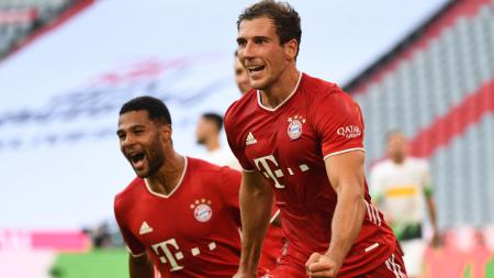 Leon Goretzka (kanan) melakukan selebrasi usai mencetak gol kemenangan Bayern Munchen atas Borussia Monchengladbach - INDOSPORT