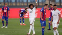 Indosport - Real Madrid merekrut Marcelo dari Fluminense untuk menggantikan Roberto Carlos dengan mahar yang sangat murah.