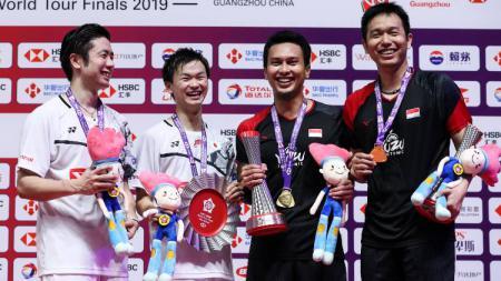 Media China, Sports Sina, menyebut persaingan antara dua pasangan Indonesia, Kevin Sanjaya/Marcus Gideon, Mohammad Ahsan/Hendra Setiawan dengan wakil Jepang, Hiroyuki Endo/Yuta Watanabe aneh. - INDOSPORT