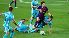 Indosport - Lionel Messi dijaga ketat dalam laga Barcelona vs Leganes