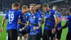 Indosport - Rampungnya gelaran kompetisi kasta kedua sepak bola Jerman 2019/20, memunculkan dua nama tim yang berhak promosi ke Bundesliga Jerman musim depan.