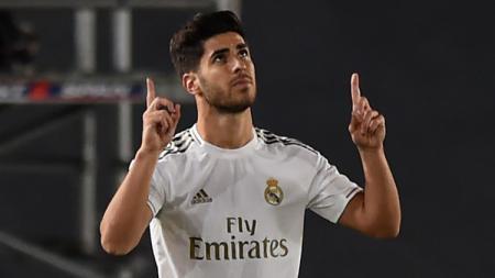 Tersingkir dari skuat utama Real Madrid, Marco Asensio dikabarkan bakal merapat ke Liverpool di tahun 2022 mendatang. - INDOSPORT