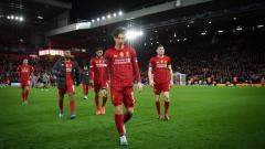 Indosport - Skuat Liverpool tertunduk lesu usai kalah dari Atletico Madrid