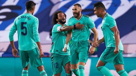 Penyerang Real Madrid, Karim Benzema, punya kesempatan untuk lakukan kudeta kepada striker Barcelona, Lionel Messi pada daftar top skor LaLiga Spanyol sementara. - INDOSPORT