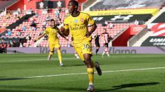 Indosport - Eddie Nketiah merayakan golnya pada pertandingan Liga Inggris antara Southampton vs Arsenal, Jumat (26/06/20).
