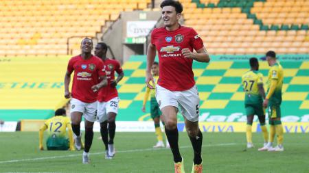 Harry Maguire berselebrasi usai mencetak gol di laga Norwich City vs Manchester United - INDOSPORT