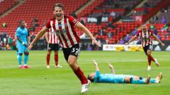 Indosport - Koneksi rahasia yang dimiliki oleh Arsenal bisa membuat salah satu bintang anyar Sheffield United menyeberang ke Emirates.