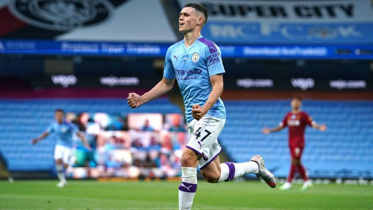 Selebrasi gol Phil Foden di laga Manchester City vs Liverpool. Copyright: Dave Thompson/Pool via Getty Images