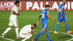 Indosport - Pertandingan pekan ke-33 LaLiga Spanyol telah rampung digelar, Jumat (03/07/20) dini hari WIB. Pimpinan klasemen sementara, Real Madrid berhasil meraih poin penuh di laga ini.