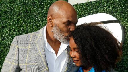 Mike Tyson bersama sang putri, Milan. - INDOSPORT