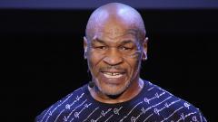 Indosport - Petinju legendaris Mike Tyson bisa mematahkan hidung orang saat siaran langsung Televisi.
