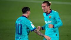 Indosport - Selebrasi Lionel Messi dan Antoine Griezmann di pekan ke-34 LaLiga Villarreal vs Barcelona.