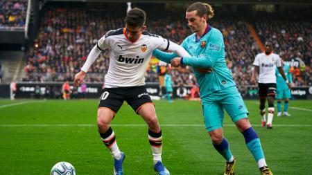 Manchester City dikabarkan telah mencapai kesepakatan dengan Valencia untuk merekrut Ferran Torres. - INDOSPORT