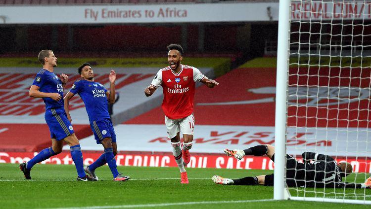 Pierre-Emerick Aubameyang merayakan gol dalam laga Arsenal vs Leicester City di Liga Inggris 2019-20, Rabu (08/07/20). Copyright: Stuart MacFarlane/Arsenal FC via Getty Images