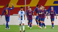 Indosport - Perayaan gol Luis Suarez di laga pekan ke-35 LaLiga Spanyol Barcelona vs Espanyol.