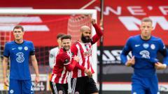 Indosport - David McGoldrick (kanan) merayakan gol dalam laga Sheffield United vs Chelsea di Liga Inggris 2019-20, Sabtu (11/07/20).