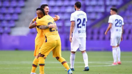 Barcelona bekuk Real Valladolid sehingga menempel Real Madrid di klasemen LaLiga Spanyol sedang Atletico Madrid raih tiket Liga Champions usai bekap Real Betis. - INDOSPORT