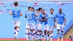 Indosport - Selebrasi gol Manchester City dalam pertandingan lanjutan Liga Inggris kontra Bournemouth, Rabu (15/7/20).