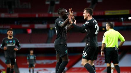Selebrasi gol Sadio Mane dalam pertandingan lanjutan Liga Inggris antara Arsenal vs Liverpool, Kamis (16/07/20) dini hari WIB. - INDOSPORT