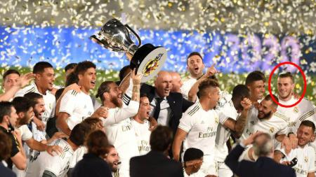 Senyuman Gareth Bale dalam euforia kemenangan Real Madrid saat memastikan diri Juara LaLiga Soayol 2019-2020. - INDOSPORT