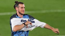 Gareth Bale tetap tersenyum meski tidak berandil dalam pertandingan kemenangan Real Madrid.