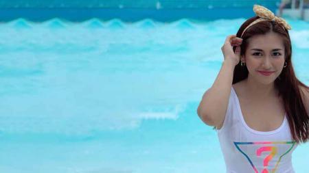 Presenter olahraga televisi Filipina bernama Roxanne Montealegre membuat netizen gagal fokus dengan unggahan foto di Instagram. - INDOSPORT