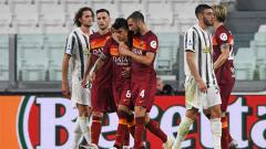 Indosport - Selebrasi pemain AS Roma usai mencetak gol ke gawang Juventus