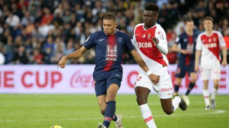 Manchester United serius untuk mendatangkan bek muda AS Monaco yang bernama Benoit Badiashile. Namun, Monaco punya permintaan tak masuk akal. - INDOSPORT