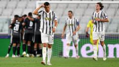 Indosport - Cristiano Ronaldo tertunduk lesu usai Lyon menambah keunggulan dari Juventus di Liga Champions
