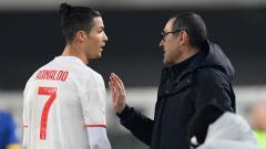 Indosport - Cristiano Ronaldo dan Maurizio Sarri saat masih melatih Juventus