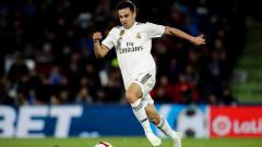 Indosport - Sergio Reguilon saat berseragam Real Madrid sebelum dipinjamkan ke Sevilla.