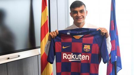Pedri yang dipercaya sebagai penerus Andres Iniesta nyaris gabung raksasa LaLiga Spanyol, Real Madrid dan bukan Barcelona jika bukan karena alam yang bergejolak. - INDOSPORT