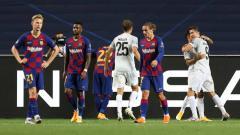 Indosport - Para pemain Barcelona terlihat kecewa setelah Bayern Munchen mencetak gol dalam laga perempatfinal Liga Champions 2019/20, Sabtu (15/08/20) dini hari WIB.