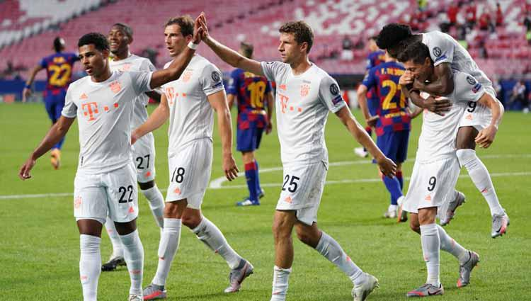 Selebrasi Thomas Mueller usai mencetak gol ke gawang Barcelona dalam laga perempatfinal Liga Champions 2019/20. Copyright: M. Donato/Getty Images for FC Bayern