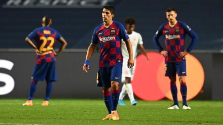 Luis Suarez tampak pasrah usai Barcelona dibantai Bayern Munchen di Liga Champions - INDOSPORT