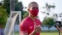 Indosport - Ryuji Utomo (Persija Jakarta) saat menjalani latihan perdana.