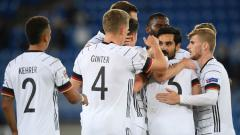 Indosport - Selebrasi gol Ilkay Gundogan di laga UEFA Nations League Swiss vs Jerman.