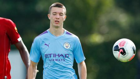 Charlie McNeill, pemain Manchester City. - INDOSPORT