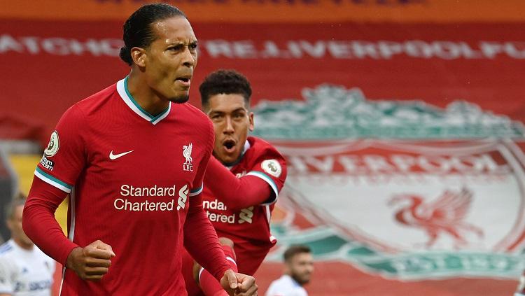 Selebrasi bBek Liverpool, Virgil van Dijk, usai mencetak gol ke gawang Leeds United dalam laga Liga Inggris, Sabtu (12/9/20). Copyright: Twitter Premier League